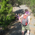 Walking and semi-climbing through the woods. We were team purple.