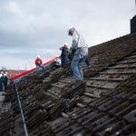 The old roof looks old, naturally. Here we are in the process of removing the old tiles.